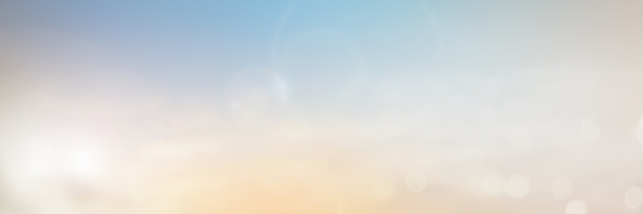 Panoramic Abstract blur nature sky bokeh texture background concept for calm faith horizon landscape, Clean sunset blurry light, sunshine on sand beach color of blue teal, relax Autumn weather.