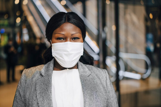 Portrait of mature businesswoman at subway station during pandemic