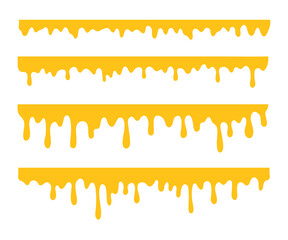 Honey is dripping. The thick yellow liquid dripping onto the ground.