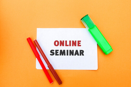 A note with the inscription Online seminar. A type of web conferencing, holding online meetings or presentations over the Internet. Webcasts, and web meetings. Webinar.