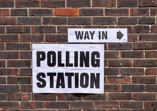 Sign indicating polling station for local elections.