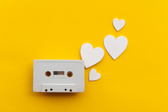 retro audio cassette tape surrounded by white love hearts