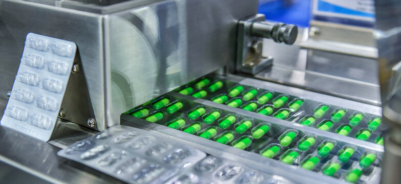 Green capsule medicine pill production line, Industrial pharmaceutical concept