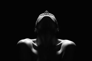 Fototapeta premium Nude Woman silhouette in the dark