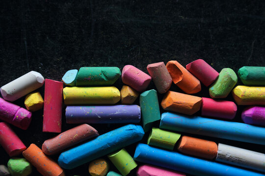 The colorful chalk on chalk board