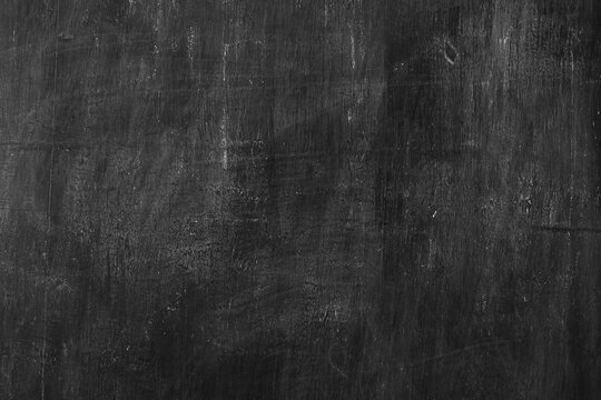 Black old wooden with scratched mark board surface texture for background.