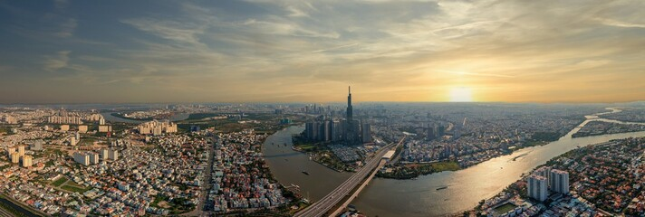 Aerial cityscape photo of Ho Chi Minh city skyline at sunset