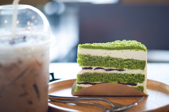 Triangle pandan layer cake filled with cream and red beans