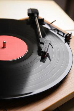 Modern vinyl record player with disc, closeup