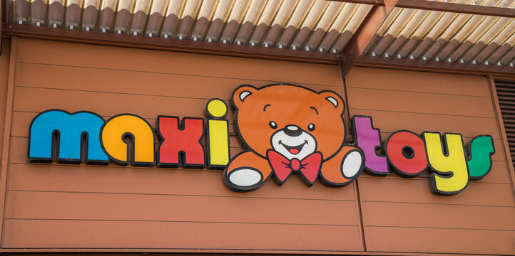 Maxi Toys logo on the front of the store specialized in the sale of toys