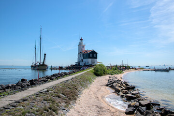 Wall Murals Horses Walking Path At The Lighthouse Marken The Netherlands 6-8-2020