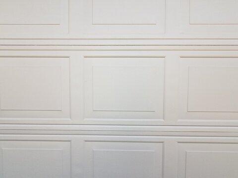 rectangle pattern on closed white garage door