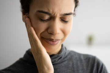 Sore African Tooth. Toothache And Decay