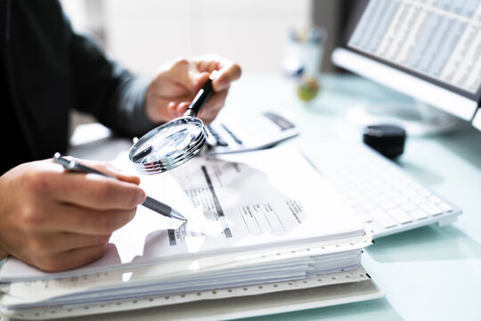 Audit And Fraud Investigation. Auditor Using Magnifying Glass