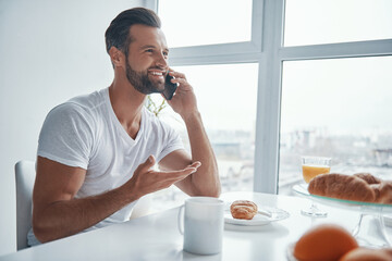 Obraz Handsome young man talking on the phone  - fototapety do salonu