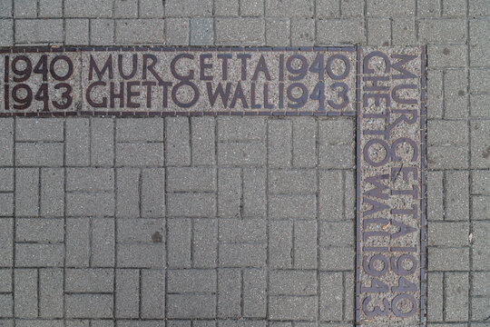 Warsaw, Poland, May 3, 2021: Ghetto wall - a commemorative symbol embedded in the pavement