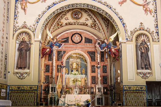 Alajar, Huelva, Spain - May 1, 2021: Main altar of Hermitage of Our Lady of the Angels from the 16th century in the Peña de Arias Montano (Rock of Arias Montano), Alajar