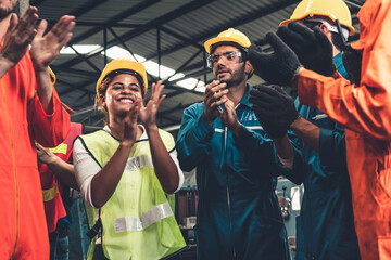 Fototapeta Skillful worker celebrate success in the factory . Industrial people and manufacturing labor concept . obraz