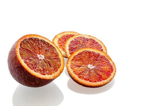 Red blood orange slices on white background