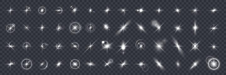 Obraz Lens flare. Camera light flash. Realistic shiny glints on transparent background. Photographic optical effects. Sunlight glares and sunbeams reflection set. Vector blinding sunshine - fototapety do salonu