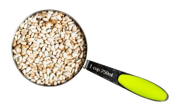Safflower seeds in measuring cup cutout