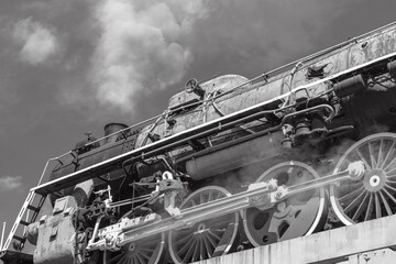 Retro locomotive on the bridge. Old steam train of the USSR era