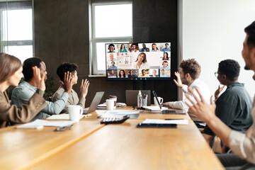 Fototapeta Diverse businesspeople making online video call to employees obraz