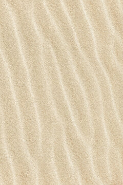 Abstract background. Diagonal sand stripes texture made by sea waves on beach.