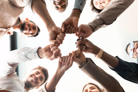 Portrait of diverse business people giving fist bump in cirle