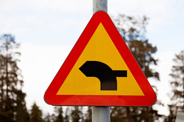 road sign showing that the thick part of the road has priority