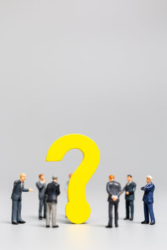 Businessman with big question. workers trying to solve the problem concept
