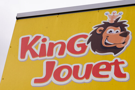 King Jouet game and child toy store logo sign kids children baby toys brand text on chain shop
