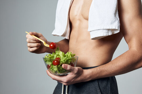 muscular torso man salad plate healthy eating lifestyle cropped view