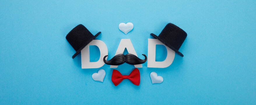 Father's Day banner with word Dad mustache and hats on blue background
