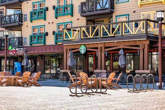 Snowshoe, USA - October 6, 2020: Mountain kids clothing accessories and toys store and Starbucks coffee cafe shop sign in West Virginia small ski resort town village