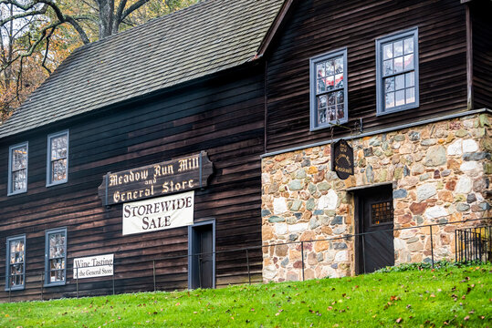 Charlottesville, USA - October 25, 2020: Meadow run mill and general store building architecture with sign for wine tasting and storewide sale by Michie tavern near Thomas Jefferson Monticello estate