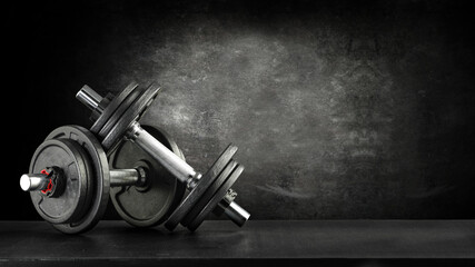Dumbells on desk and free space for your decoration.