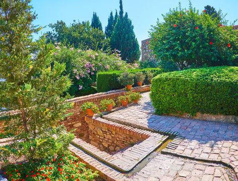 Jets of water in Alcazaba garden, Malaga, Spain