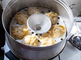 Fototapeta aluminum steamer with cooking manti dumpling obraz