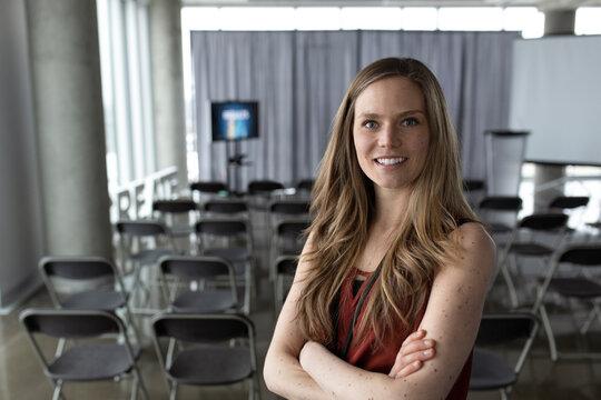 Portrait confident businesswoman at conference