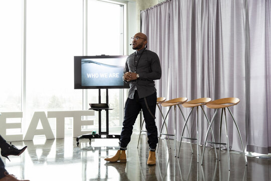 Male inspirational speaker presenting at creative conference