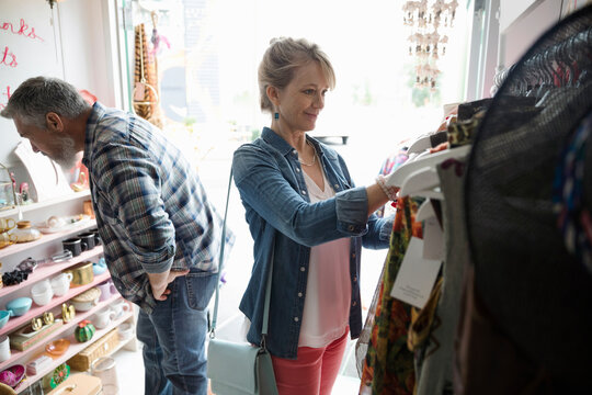Woman shopping, browsing clothing at bazaar marketplace