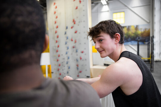 Young male climbers talking in climbing gym