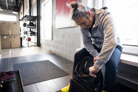 Senior man with backpack in cross training gym