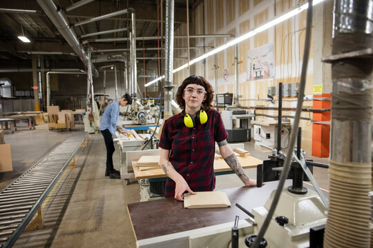 Portrait of worker at workspace in distribution warehouse