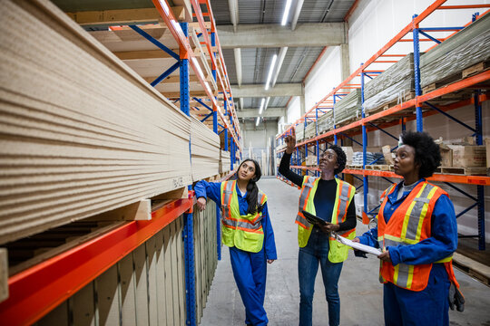 Colleagues discussing work in distribution warehouse