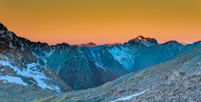 Southern alps in sunset time, looking east, orange glowing atmosphere.