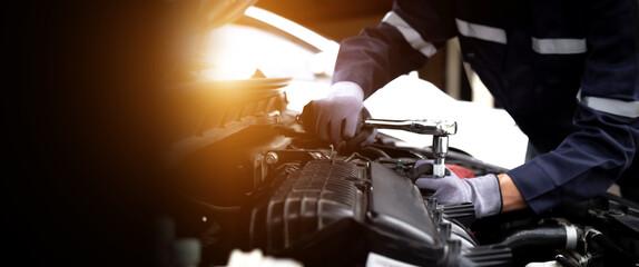 Obraz Auto mechanic working on car engine in mechanics garage.Repair service,car service, repair, maintenance concept. - fototapety do salonu