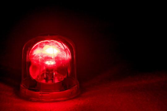 Emergency rotating alarm red light at night.
