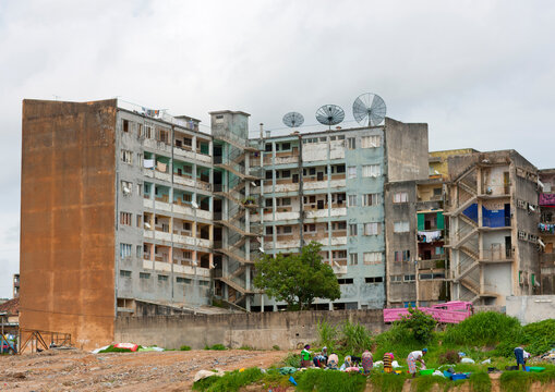 Women Doing The Laundry In Basins In Front Of Their Housing Building, Huambo, Angola